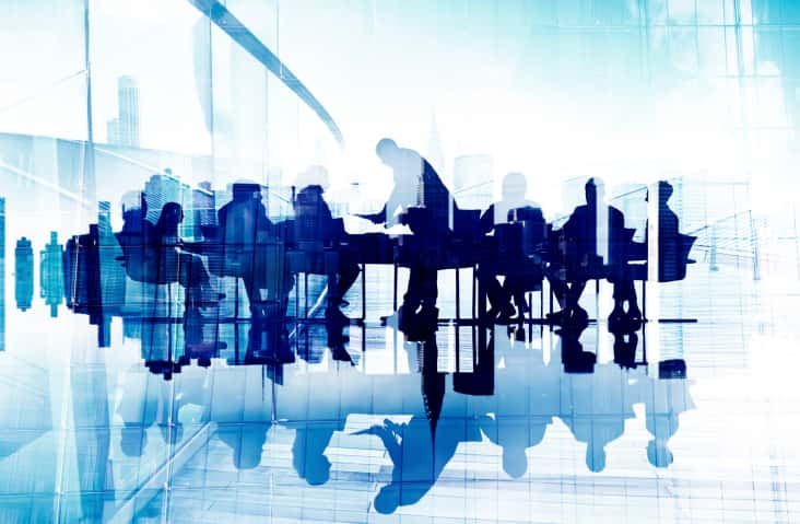 Abstract Image of Business People's Silhouettes in a Meeting