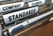 Close up on a file tab with the word standards, focus on the main word and blur effect. Concept image for illustration of quality standard